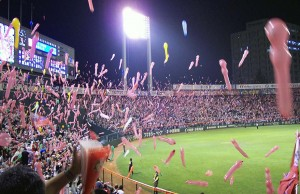 Fans release noise-making balloons at a Hirshima Toyo Carp baseball game