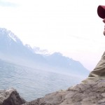 Jason Kammerdiener sitting next to Lake Geneva in Montreux, Switzerland