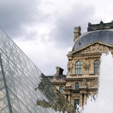 Glass pyramid and ornate building of the Louvre Museum in Paris, France