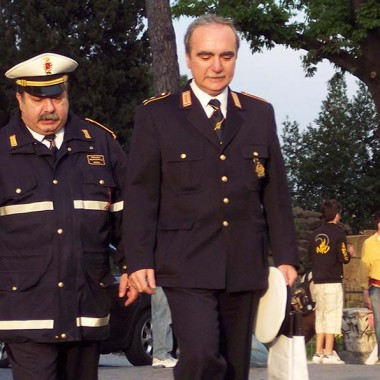 Two policemen in Rome, one of whom looks like Super Mario
