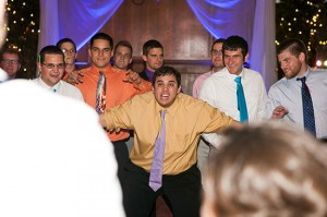 Wedding guests boxes out during the garter toss