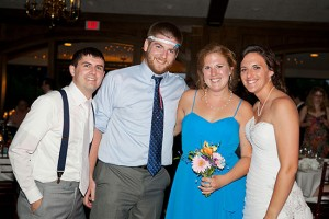 Bride and groom with bouquet and garter toss winners
