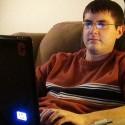 Jason Kammerdiener writing on a laptop on his lap