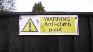 "Sign reading ""Warning: Anti-climb paint"""