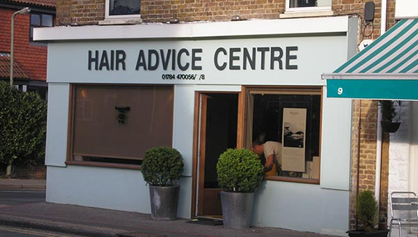 "Storefront with signage reading ""Hair Advice Centre"""