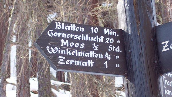 "Sign with place names like, ""Blatten, Gornerschlucht, Moos, Winkelmatten, and Zermatt"""