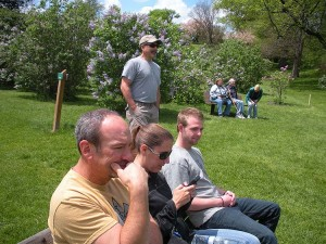 The family takes a break on a bench at the Lilac Festival
