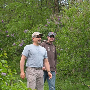 Uncle Mike and Shawn walk through the Lilac Festival