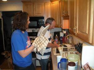 Katie and Uncle Barry wash the dishes