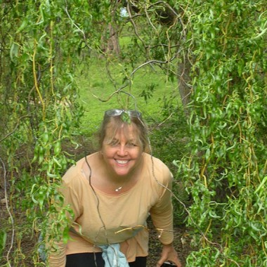 Aunt Linda pops out from under a tree