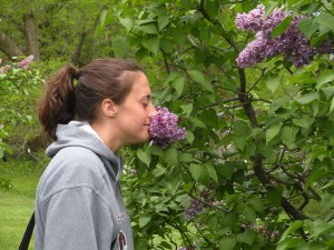 Katie smelling a lilac
