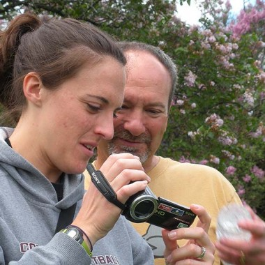 Katie and Uncle Barry review photos at the Lilac Festival