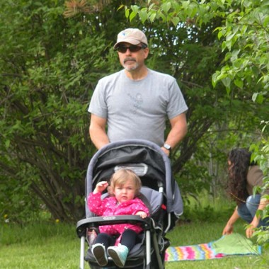 Uncle Mike pushes Addy in her stroller