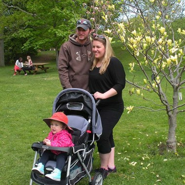 Sarah, Shawn, and Addy post for a photo in the gardens