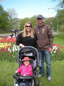Sarah, Shawn, and Addy pose for a photo in the tulip garden
