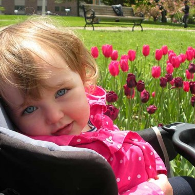 Addy with a bed of tulips in the background