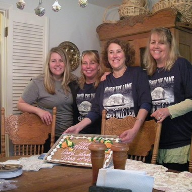 Family mothers pose with at Mothers' Day cake