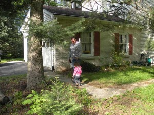 Addy finds Doug at the corner of the house