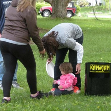 Addy examines the Kan Jam frisbee with Katie