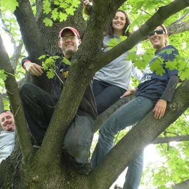 Doug, Jason, Katie, and Leah climbing the tree