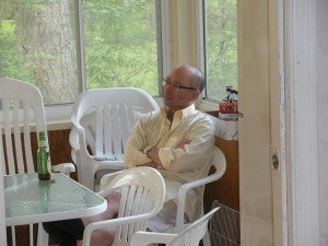 Uncle Howie listens intently on the porch