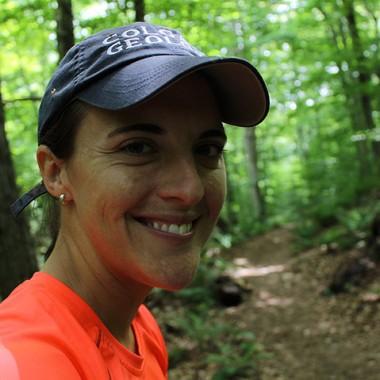 Katie smiles while hiking the Vista Trail